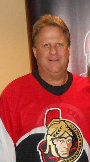 Dwight Brown at a Sens game in 2015