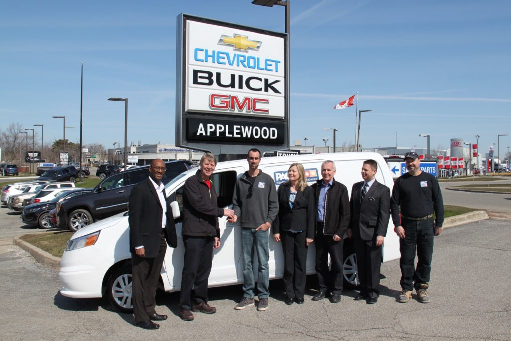 Winner Nico Marcantonio accepts the keys to a brand new Chevrolet City Express LT. (From left to right) Fred Dixon, Manager, GM Canada Fleet & Commercial Sales, Warren Heeley, president HRAI, winner Nico Marcantonio, Pac Heating & Air Conditioning, Barb Tate, Applewood Chevrolet, Eddie Stoncius, Farmbro Inc., Jeff Monforton, GM Canada Fleet & Commercial Sales, and Phil Lemay, Pac Heating & Air Conditioning.