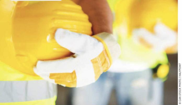 yellow hard hats stock image